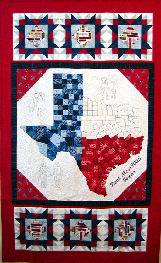 don't mess with texas is a fiber work centered around the state of Texas with detail of all  its counties, and machine embroidered figures surrounding it of a longhorn, a horse, a boy leading a horse and the   well known statement