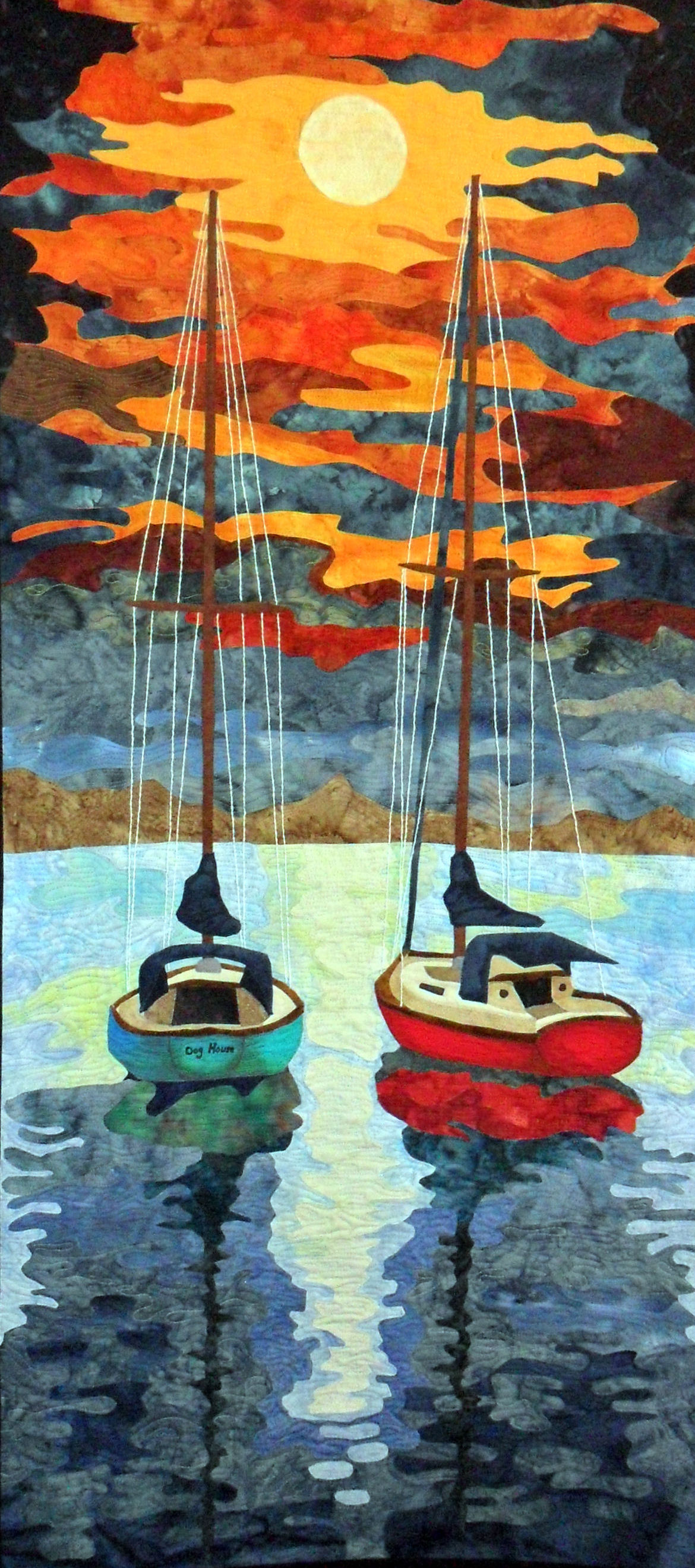 Kemah After Hours is a Fiber Art work representing two boats floatin side by side at night in Kemah,Texas with the moon reflecting on the water and the breeze gently rockin the boats and singing in the rigging