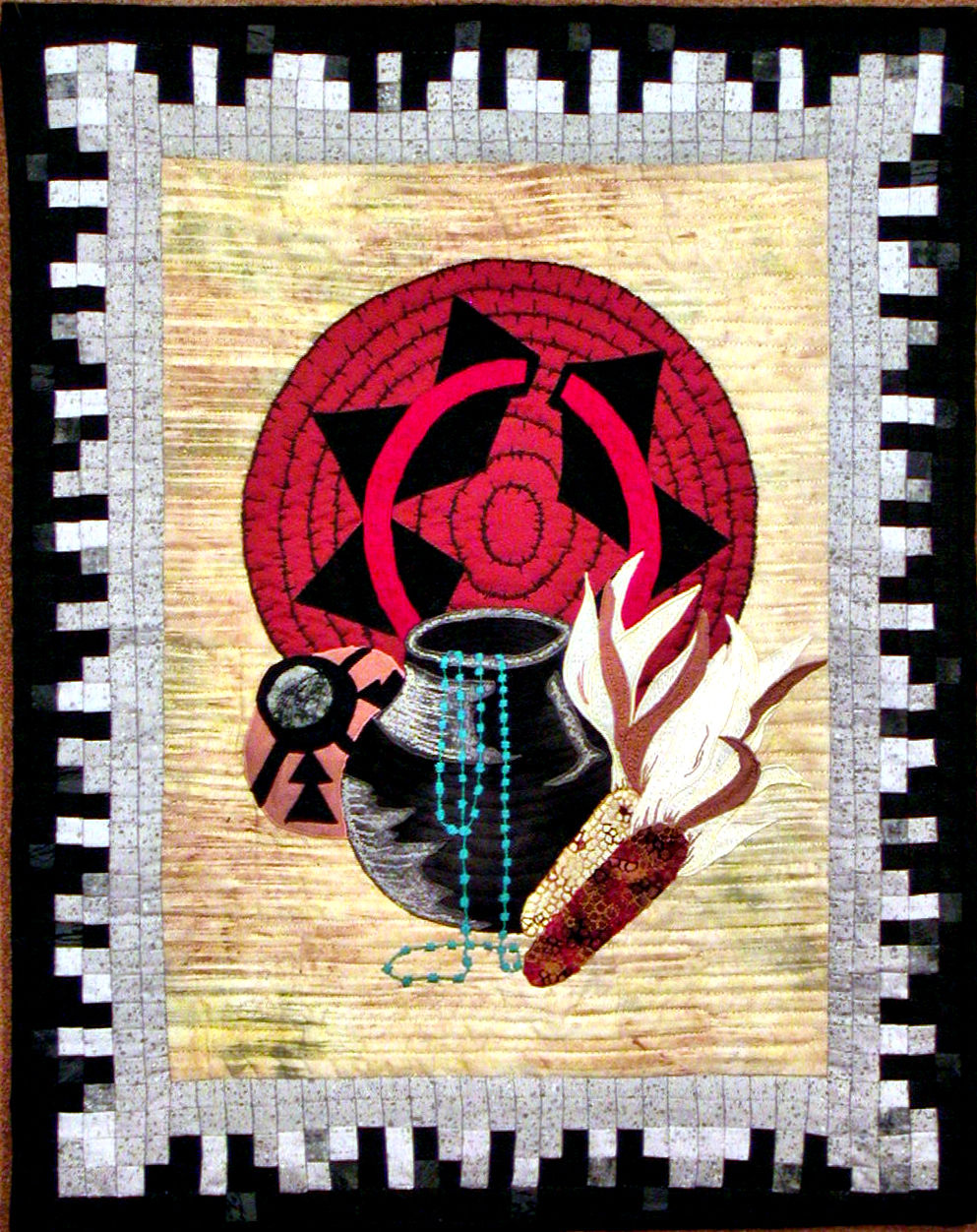 navajo still life small is a miniature fiber art work showing images of indian life such as pottery and  dried corn and navajo basketry