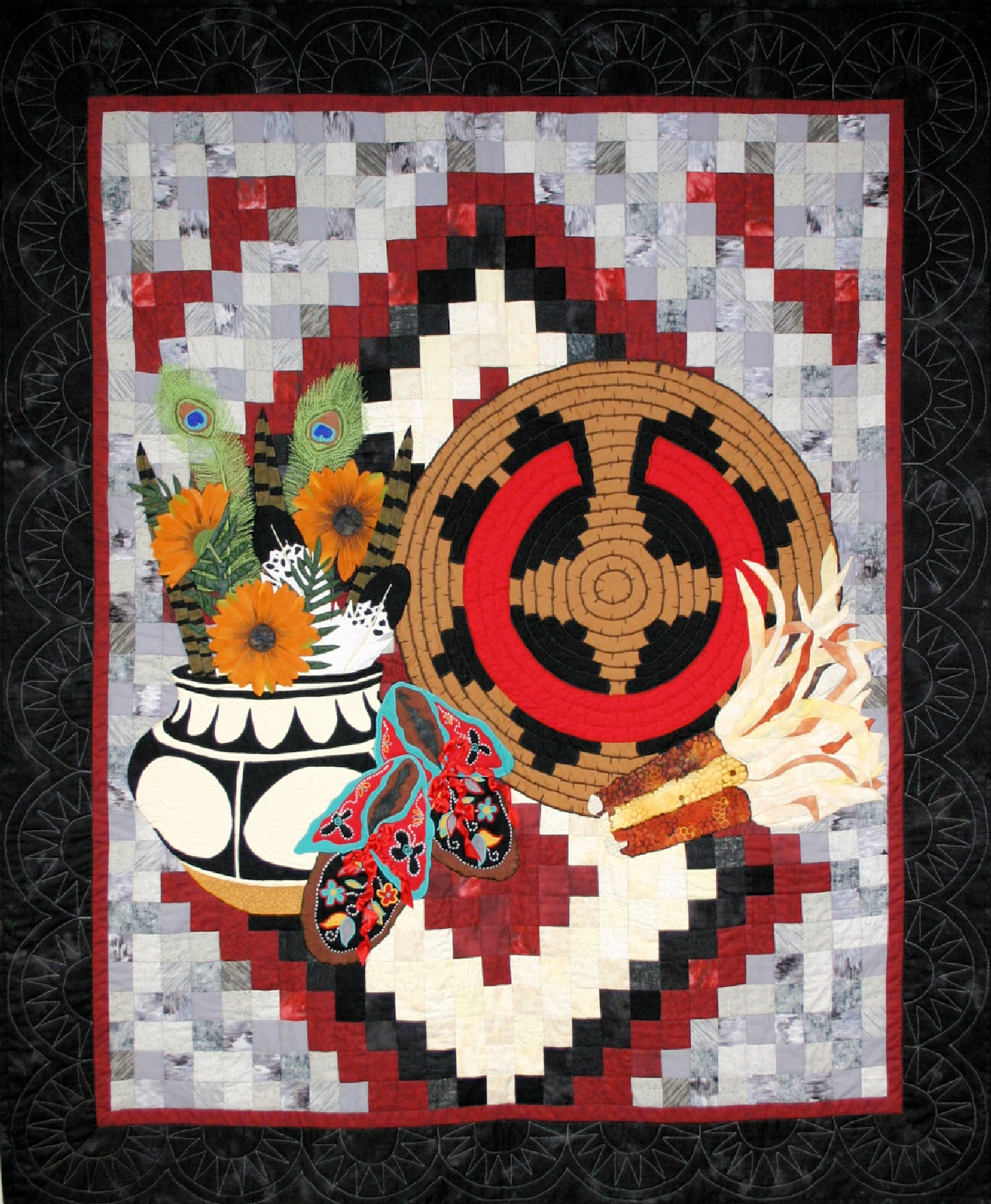 Navajo Still Life is a fiber art work with an Indian Basket, a black and white  navajo style bowl and some colorful dried indian corn and moccasins with detailed ribbon work backed by a navajo style rug. This work was a juried finalist  at the Houston International Quilt Festival in 2007
